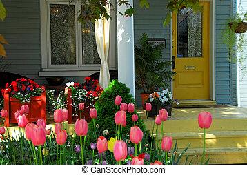 Porche de casa con flores