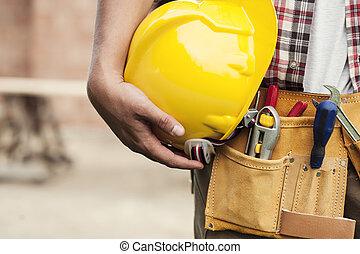 primer plano, trabajador duro, construcción, tenencia, sombrero