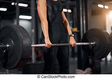 profesional, manos, barra con pesas, hembra
