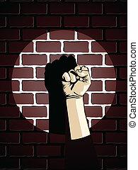 Puño contra pared de ladrillo