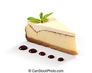 Rebanada de tarta de queso decorada con hojas de menta