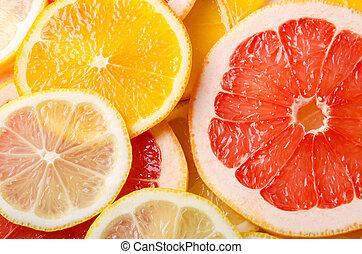 Rebanadas de fruta de Citrus de limón, naranja, pomelo para el fondo.