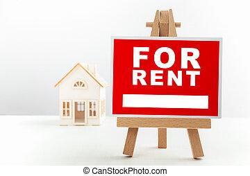 Red para el cartel de renta inmobiliaria frente a una pequeña casa modelo.