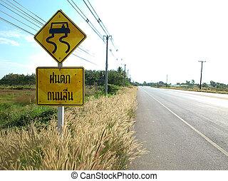 Resbaladizo cuando hay señal de aviso en Tailandia