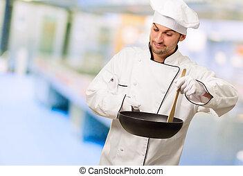 Retrato de un chef preparando comida