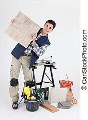 Retrato de un recolector con sus herramientas y materiales de construcción