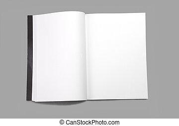 Revista blanca en blanco aislada en el fondo gris
