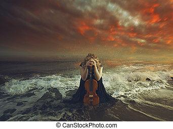 Rezando con violín