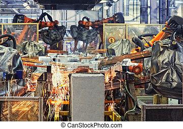 Robots en una fábrica de coches