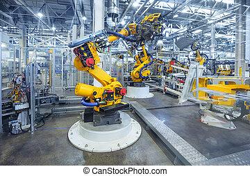 Robots en una planta de coches