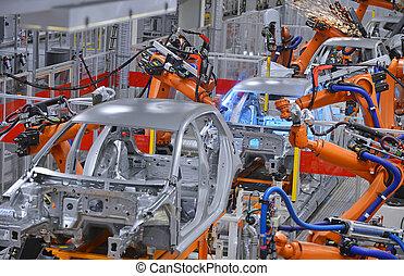 Robots soldando en la fábrica
