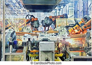 Robots soldando en una fábrica de coches