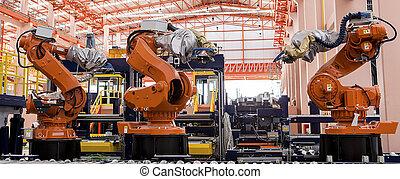 Robots soldando en una línea de producción