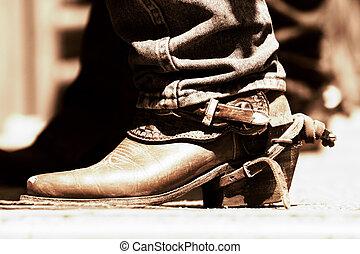 Rodeo, botas y espuela, tono de cobre