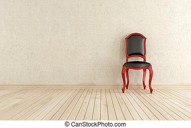 Rojo y negro, silla contra pared