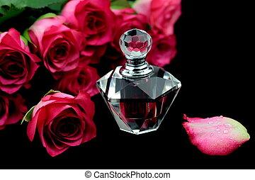 Rosas rosas y una botella de perfume