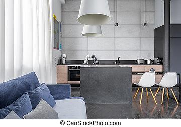 Sala de estar con sofá azul