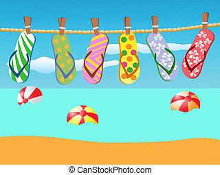 Sandalias de playa colgadas en una cuerda