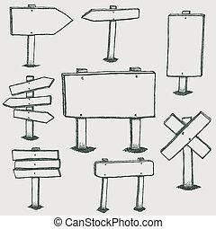 Señales de madera y flechas de dirección