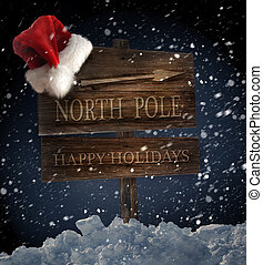 Signo de madera con sombrero de Santa sobre fondo nevado