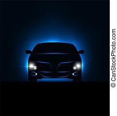 Silueta de coche con faros en la oscuridad