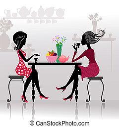 Silueta de hermosas chicas en los cafés
