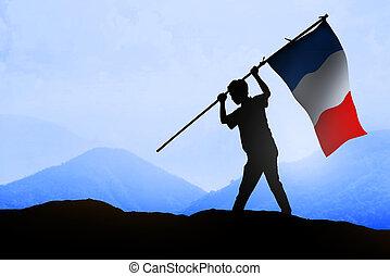 Silueta de hombre sosteniendo bandera de Francia