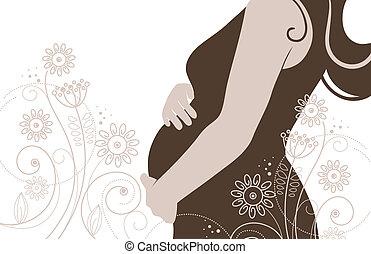 Silueta de mujer embarazada en flores