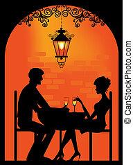 Silueta de una pareja en el restaurante