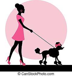 Silueta femenina con un perro