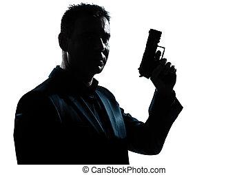 Silueta, retrato de hombre con pistola