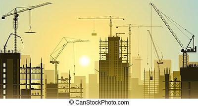Sitio de construcción con grúas torre