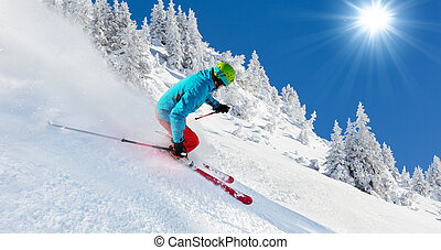 Skier en piste corriendo cuesta abajo