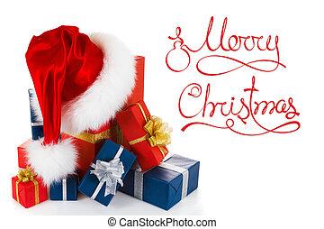 Sombrero de Papá Noel rojo de Navidad con regalos aislados en blanco