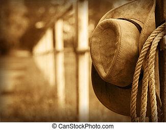 Sombrero vaquero occidental y lazo