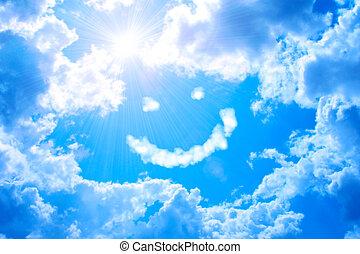 Sonrie de la nube y el sol brillante en el cielo azul