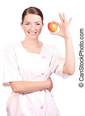 sonriente, enfermera, manzana, teniendo arriba