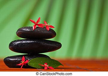 Spa y masajes siguen siendo vida balanceando piedras