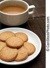 té, galletas, taza