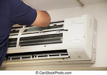 Técnicos de reparación aire acondicionado