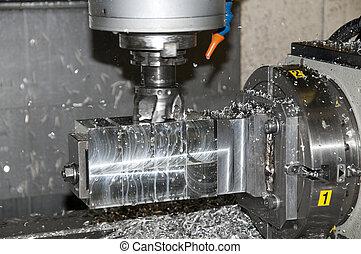 Taladrando y midiendo CNC en el taller