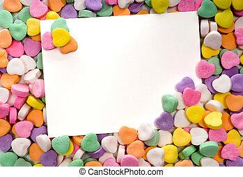 Tarjeta en blanco rodeada, enmarcada por dulces
