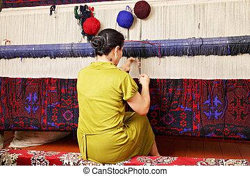Tejedor de alfombras