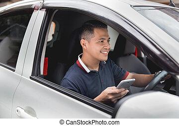 Teléfono móvil mientras conduce