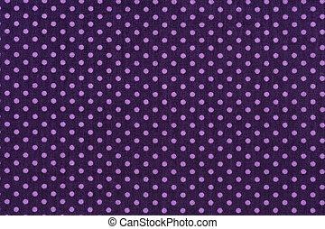 Tela púrpura y pequeños lunares blancos.