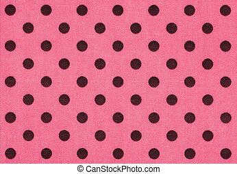 Tela rosa con lunares oscuros