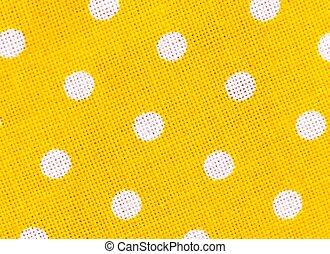 Textura de tela amarilla con lunares blancos