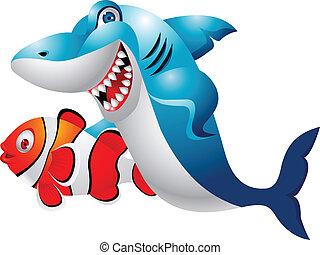 Tiburón con peces payasos