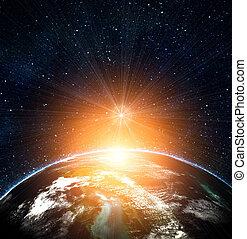 Tierra azul en el espacio con sol naciente