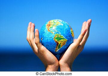 Tierra en manos. Imagen conceptiva